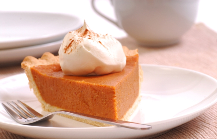 Slice of pumpkin pie with whipped cream